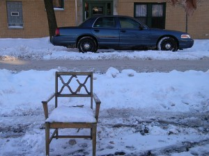A chair guards a parking spot on Wolcott in Wicker Park.