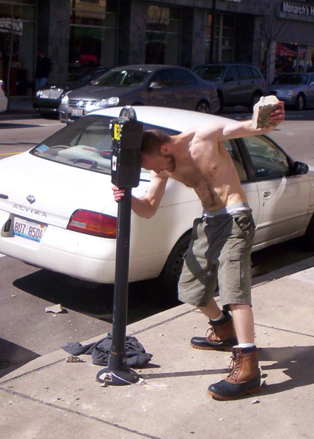 An enraged gentleman attacks a parking meter in Lakeview In March, 2009,