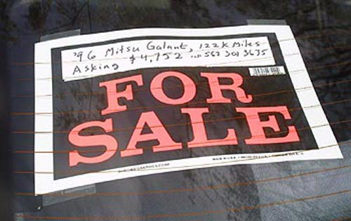 For Sale sign on the back window of my car while it was parked