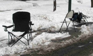 A pair of chairs protect a spot on one of Chicago's residential streets.