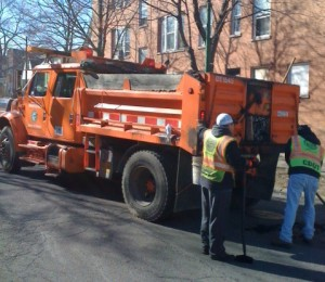 CDOT crews fill potholes on the North Side in 2013.