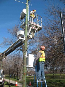 Technicians for American Traffic Solutions install a test camera near Warren Park on Western Avenue near Warren Park.