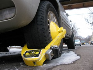 The Denver boot immobilizes another Chicago scofflaw.