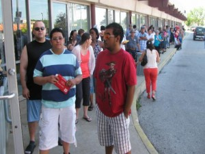 Lines to buy Chicago city stickers flow out the door of the city payment center at 2550 W. Addison St. Friday morning.