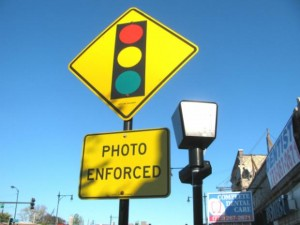 A sign on Irving Park Road warns drivers of the red light camera at at Kedzie.