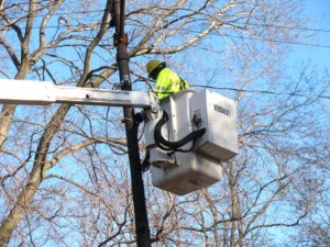 Contractors bring in the electrical power for a new speed camera near Irving Park and Clark Street.