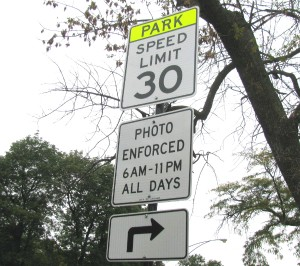 A sign warns drivers of  speed cameras nearby.