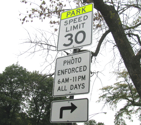 A sign warns drivers of speed cameras on Roosevelt Road near Douglas Park.