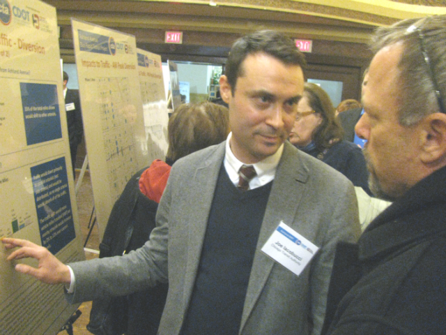 The CTA's Joe Iacobucci talks to an attendee at Wednesday's Ashland BRT open house at the Pulaski Park Fieldhouse.