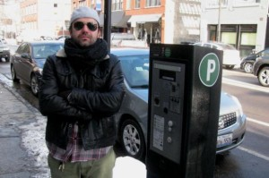 Billy stands next to the parking meter pay box on Damen Avenue in Wicker Park where he was paying to park while his car was getting ticketed.