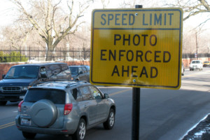 A sign warns drivers on Irving Park Road near Challenger Dog Park warn drivers of speed camera enforcement.