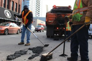 City pothole repair crews patch asphalt on Halsted Street Saturday. Photo credit: Quinn Ford/DNA Info.
