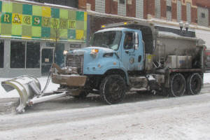 A city snow plow travels down Milwaukee Avenue Monday afternoon.
