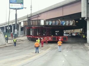 Workers remove the bridge over Ashland Avenue Saturday morning. Photo credit: Ald. Scott Waguespack (32nd).