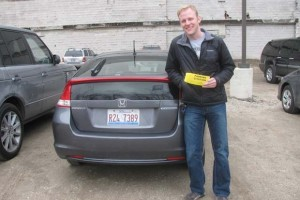 "Ben shows off a ""parking ticket"" he received at an LAZ Parking lot in Lincoln Park."
