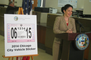 City Clerk Susana Mendoza stands next to an enlarged copy of the 2014 Chicago city sticker at a press conference Monday.