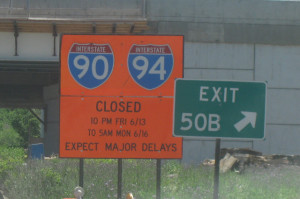 A sign warns of last weekend's closures for the Ohio Street Bridge removal.