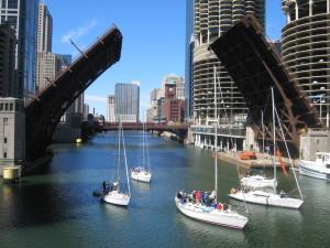 A small flotilla of boats passes through the open State Street Bridge on the Chicago River, Chicago, Illinois. Photo credit: Jeremy Atherton, © 2006.