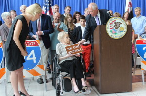 Former mayor Jane Byrne holds a sign for her now namesake interchange. Photo credit: Ted Cox/DNA Info.