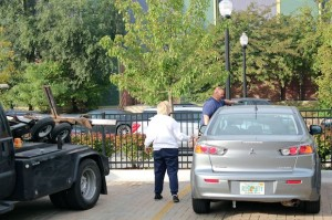 A driver argues with a tow truck driver near the British School. Photo credit: DNA Info.