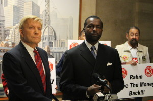 Mayoral candidate Ald. Bob Fioretti (2nd) and Mark Wallace, director of Citizens to Abolish Red Light Cameras speak at a press conference at City Hall Monday. Photo credit: Ted Cox/DNA Info.