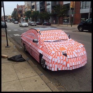 A car in West Town is completely covered in parking tickets by some creative pranksters.
