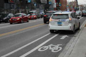 A cab parks in a bike lane in the 1400 block of N. Halsted. Photo credit: Mina Bloom/DNA Info.