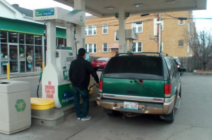 A driver takes advantage of gas under $2 a gallon for the first time in seven years at a BP gas station in the Logan Square neighborhood.