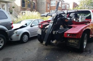 A tow truck is abandoned in the Irving Park neighborhood after smashing into 7 parked cars.